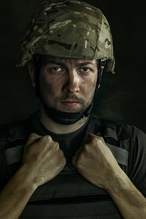 Close up portrait of young male soldier