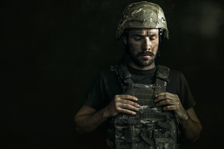 Save life for other people. Half-lenght portrait of young male soldier.