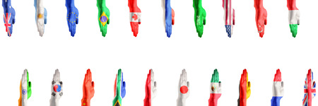 Hands colored in flags of participating countries of The Group of Twenty, major advanced and emerging economies on white