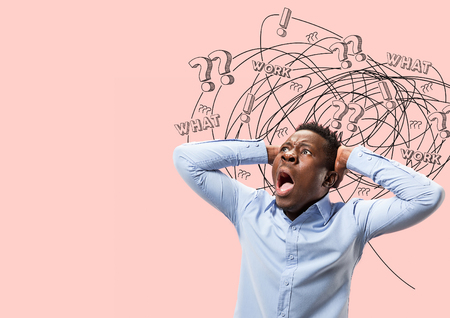 Young african-american man with mixed thoughts against trendy coral background. Negative space. Concept of thinking confusion, stress out, misunderstanding, facial expression, human emotions.
