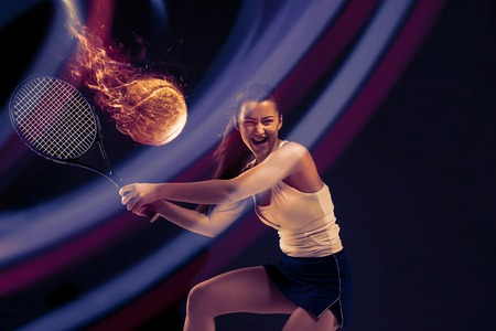 Full length portrait of young woman playing tennis isolated on dark background. Healthy lifestyle. Fitness, sport, exercise concept. The female model in motion or movement. Creative collage.