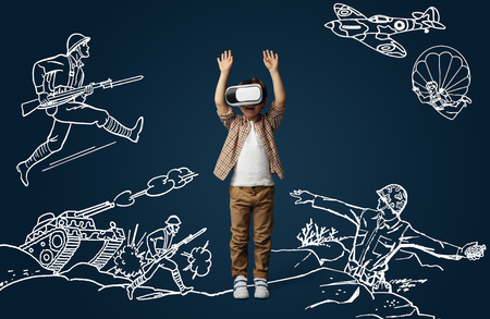 Painted dream about shooters game or being soldier on the war. Little boy or child with virtual reality headset glasses. Concept of cutting edge technology, video games, innovation, childhood, dreams. Stock Photo