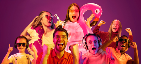 Beautiful female and male models isolated on pink neon lights studio background. Astonished woman and men. Facial expression, summer, resort, summertime or weekend concept. Trendy colors. Collage. Stock Photo
