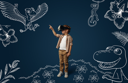 Painted dream about Jurassic period with dinosaurs in the jungle. Little boy with virtual reality headset glasses. Concept of cutting edge technology, video games, innovation, childhood, dreams.