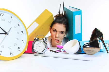 Tired forever. Young woman getting a lot of work and deadline, being under the pressure of the deals. Pressed by folders with papers. Concept of office workers troubles, business, problems and stress.