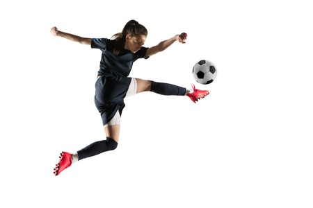 Young female football or soccer player with long hair in sportwear and boots kicking ball for the goal in jump isolated on white background. Concept of healthy lifestyle, professional sport, hobby. Archivio Fotografico - 123703561