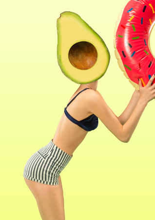 Female body with swim ring headed by a juicy avocado against green background. Negative space to insert your text. Modern design. Contemporary art collage. Vacation, summer, resort.