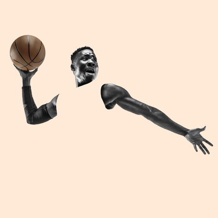 Full length portrait of a basketball player with a ball isolated on studio background. Fit african american athlete. Motion, activity, movement, advertising concept. Abstract design. Stock Photo