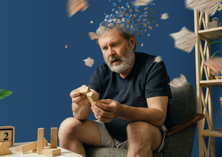 Drown image of losing of mind. Old bearded man with alzheimer desease has problems with his hands motor skills. Concept of illness, memory loss due to dementia, healthcare, depression, stress out.
