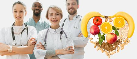 Healthcare people group recommend healthy nutrition. Professional smiling doctors posing at hospital office or clinic. Medical technology research institute and doctor staff service concept.