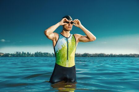 Professional triathlete swimming in rivers open water.