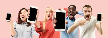 Portrait of people showing mobile phones isolated over coral
