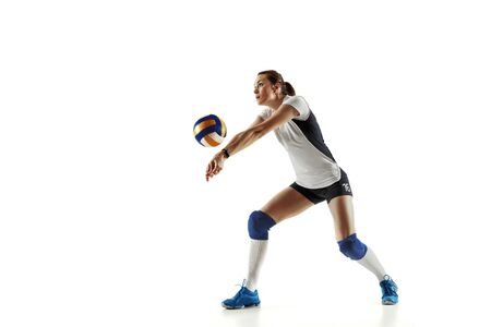 Young female volleyball player isolated on white studio Reklamní fotografie