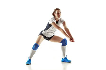 Young female volleyball player isolated on white studio