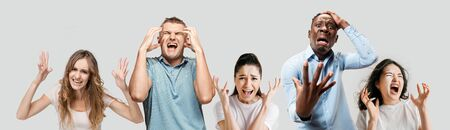 Horrible, stress, shock. Half-length portrait isolated at white studio background. Young emotional surprised people clasping head in hands. Human emotions, facial expression concept. Creative collage.