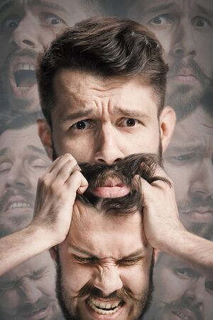 Close up shot of sad and angry emotion on face of discouraged man. Young caucasian male model angrying, scratching, screaming while holding his head. Mental health problems, troubles. Creative collage.