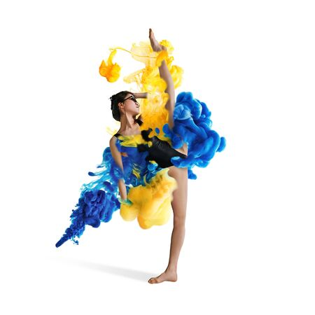 Creative collage formed by color dissolving in water on white background. Bright combination of colors. Young dancer in clouds of smoke or dissolves. Graceful, flexibility and elegance.