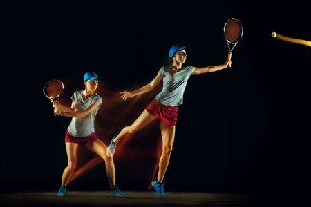 One caucasian woman playing tennis isolated on black background in mixed and stobe light. Fit young female player in motion or action during sport game. Concept of movement, sport, healthy lifestyle. Stock Photo - 126259428