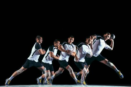 Caucasian young handball player in action and motion in mixed and strobe light on black studio background. Fit professional sportsman. Concept of sport, movement, energy, dynamic, healthy lifestyle.
