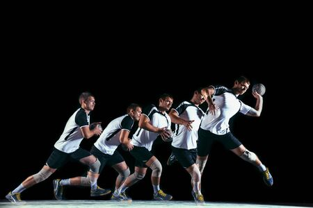 Caucasian young handball player in action and motion in mixed and strobe light on black studio background. Fit professional sportsman. Concept of sport, movement, energy, dynamic, healthy lifestyle. Stock Photo - 127655480