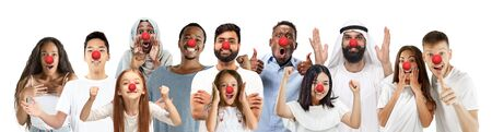 Collage of happy caucasian and african-american people as a clowns celebrating red nose day. Male and female models on white studio background. Victory, delight concept. Human facial emotions. Stock Photo