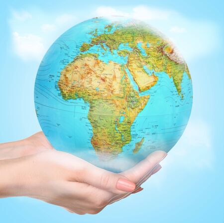 We live here everyday. People of the Earth advocate for preservation of nature and life on the planet. Eco problems or concept of trave, discovering new places. Female hands holding a globe caressly. Stock fotó