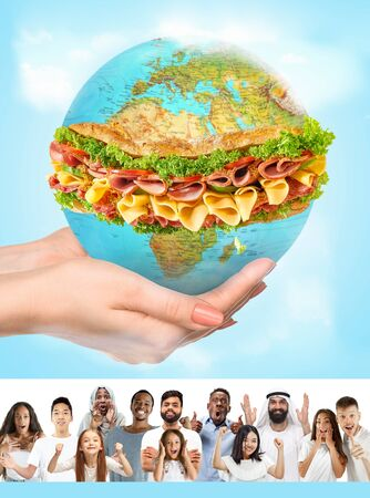 We are that we eat everyday. Young caucasian, arabian, african-american and asian people advocate for preservation of healthy food on the planet. Save the taste of nature for saving the youth. Stock Photo