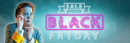 Black friday, sales concept. Neon lighted letters on gradient background. Astonished woman pointing. Negative space. Modern design. Contemporary art. Creative conceptual and colorful collage. Stock Photo