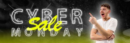 Cyber monday, sales, purchases concept. Neon lighted letters on gradient background. Astonished man pointing. Negative space. Modern design. Contemporary art. Creative conceptual and colorful collage. Reklamní fotografie