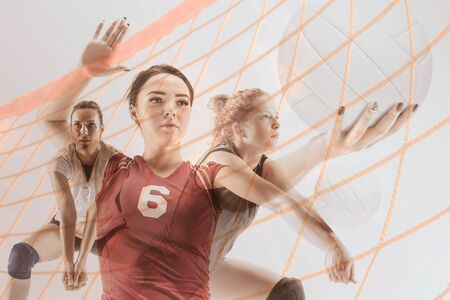 Collage of young female volleyball players on white studio background. Woman in sports equipment and shoes or sneakers training. Concept of sport, healthy lifestyle, motion and movement. 版權商用圖片