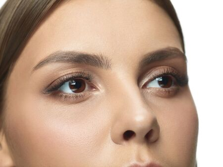 Close-up portrait of young womans eyes with no wrinkles. Female model with well-kept skin. Concept of womens health and beauty, cosmetology, cosmetics, self-care, body and skin care. Anti-aging.