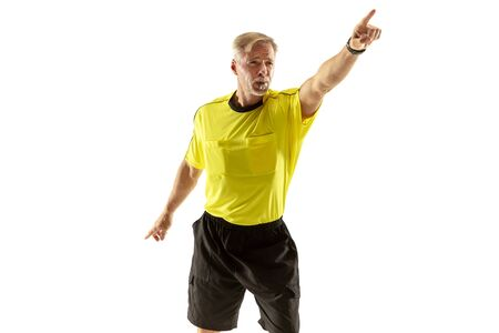 Referee gives directions with gestures to football or soccer players while gaming isolated on white studio background. Concept of sport, rules violation, controversial issues, obstacles overcoming.