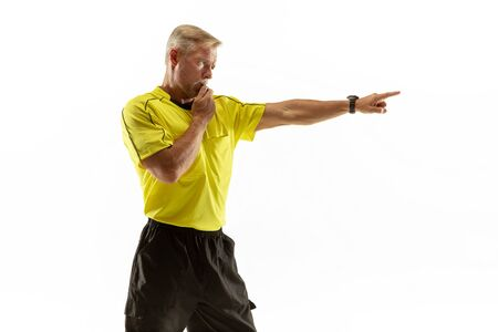 Referee gives directions with gestures to football or soccer players while gaming isolated on white studio background. Concept of sport, rules violation, controversial issues, obstacles overcoming. Stockfoto
