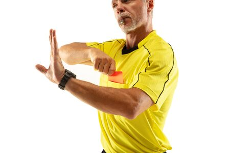 Referee showing a red card and gesturing to a football or soccer player while gaming isolated on white studio background. Concept of sport, rules violation, controversial issues, obstacles overcoming.