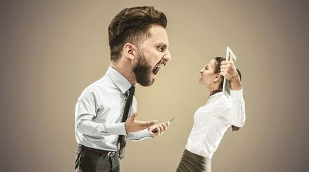 Angry businessman screaming at employee in the office. Caucasian woman is under the pressure and agressia from her boss. Office work and problem, corporate, business concept.