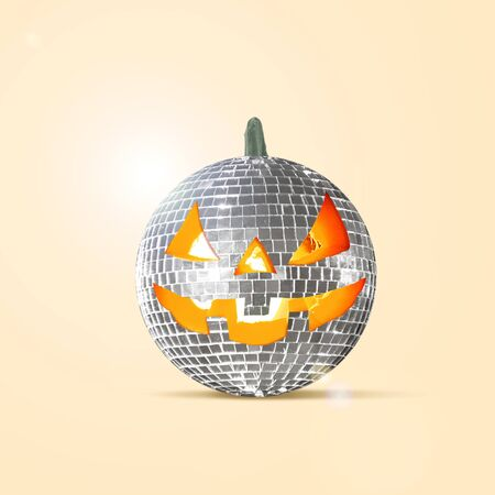 Scary pumpkin on yellow background, the night of fear. Modern design with the discoball. Halloween, black friday, cyber monday, sales, autumn concept. Flyer for your advertising. Contemporary art collage.
