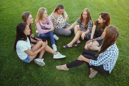 Different and happy in their bodies. Young women smiling, talking, walking and having fun together outdoors on sunny summers day at park. Girl power, feminism, womens rights, friendship concept. Stockfoto