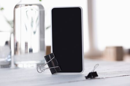 Mock up empty black smartphone screen on blurred Stock Photo
