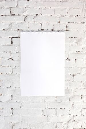 Mock up blank empty picture or sheet on the white brick wall
