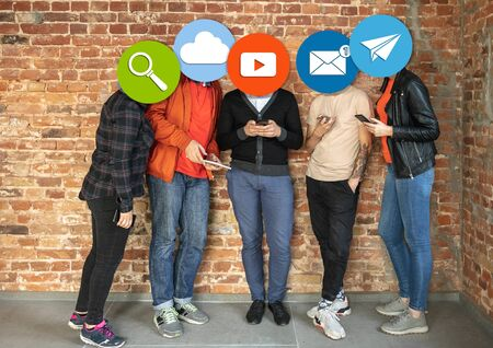 Creative millenial people connecting and sharing social media. Modern UI icons as heads. Concept of contemporary technology, networking, gadgets in our common life. Yong happy men and women with smartphones and tablet. 版權商用圖片