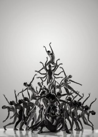The group of modern ballet dancers. Contemporary art ballet. Young flexible athletic men and women in tights. Negative space. Concept of dance grace, inspiration, creativity. Made of shots of 11 models.
