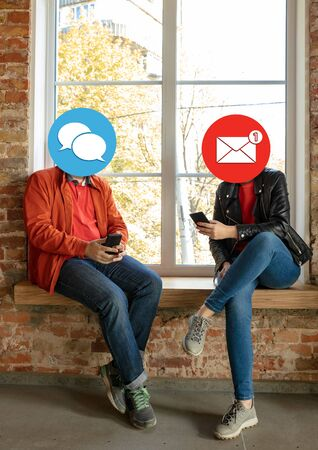 Creative millennial people connecting and sharing social media. Modern UI icons as heads. Concept of contemporary technology, networking, gadgets in our common life. Yong happy men and women with smartphones and tablet.