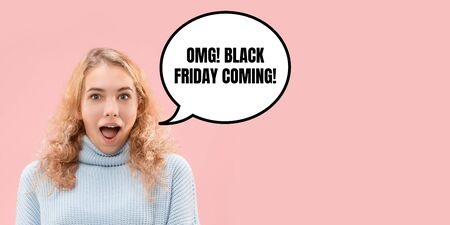 Portrait of woman surprised and shocked of black friday on coral background. Concept of sales, black friday, cyber monday, finance, business, purchases. Online shops and payments bill. 스톡 콘텐츠