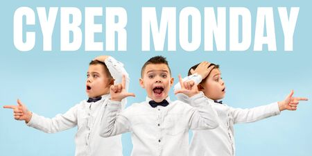 Portrait of young caucasian boy calling for cyber monday on blue background. Astonished. Concept of sales, black friday, cyber monday, finance, business. Online shops and payments bill.