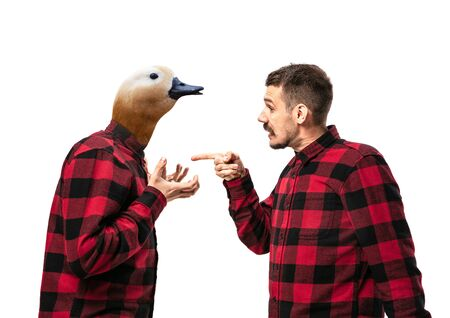 Portrait of man arguing with himself as a goose on white studio background. Concept of human emotions, expression, mental issues, internal conflict, split personality. Copyspace. Scream. Reklamní fotografie