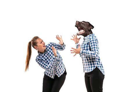 Portrait of young woman arguing with herself as a dog on white studio background. Concept of human emotions, expression, mental issues, internal conflict, split personality. Negative space.
