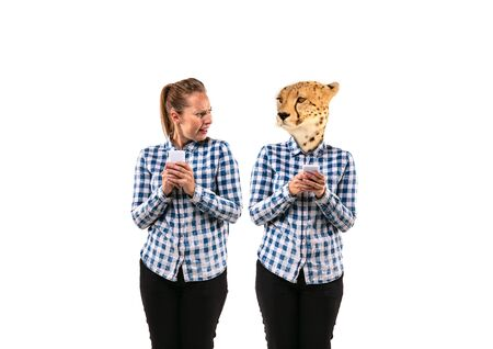 Portrait of young woman arguing with herself as a leopard on white studio background. Concept of human emotions, expression, mental issues, internal conflict, split personality. Negative space.