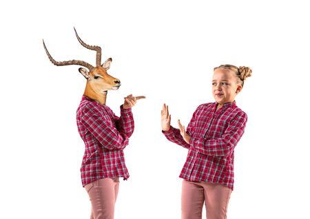 Young handsome girl arguing with herself as a deer on white studio background. Concept of human emotions, expression, mental issues, internal conflict, split personality. Agressive talking. Reklamní fotografie
