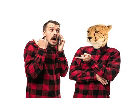Portrait of man arguing with himself as a leopard on white studio background. Concept of human emotions, expression, mental issues, internal conflict, split personality. Copyspace. Scream. Reklamní fotografie