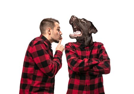 Portrait of man arguing with himself as a dog on white studio background. Concept of human emotions, expression, mental issues, internal conflict, split personality. Copyspace. Scream. Stock Photo
